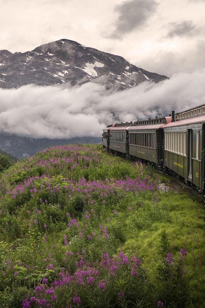 "<p><strong>Where:</strong> White Pass and Yukon Route Railroad, Alaska</p><p><strong>Why We Love It: </strong>Built in the late 19th century during the Klondike Gold Rush, this scenic railroad climbs nearly 3,000 feet in 20 miles giving riders panoramic (and cliff-hanging!) views of the surrounding mountains.<br></p><p><strong>RELATED:</strong> <a href=""https://www.countryliving.com/life/travel/g2312/scenic-train-rides-across-america/"" rel=""nofollow noopener"" target=""_blank"" data-ylk=""slk:The Most Scenic Train Rides In North America"" class=""link rapid-noclick-resp"">The Most Scenic Train Rides In North America</a><br></p>"