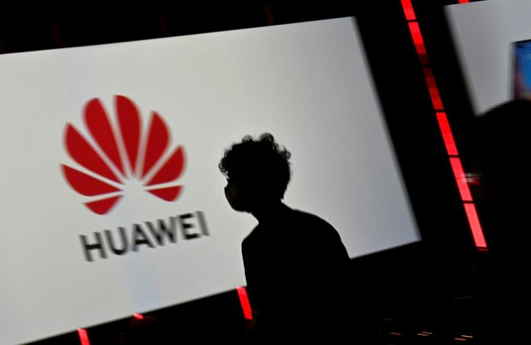 Unfriended abroad, China's tech giants seek home comfort
