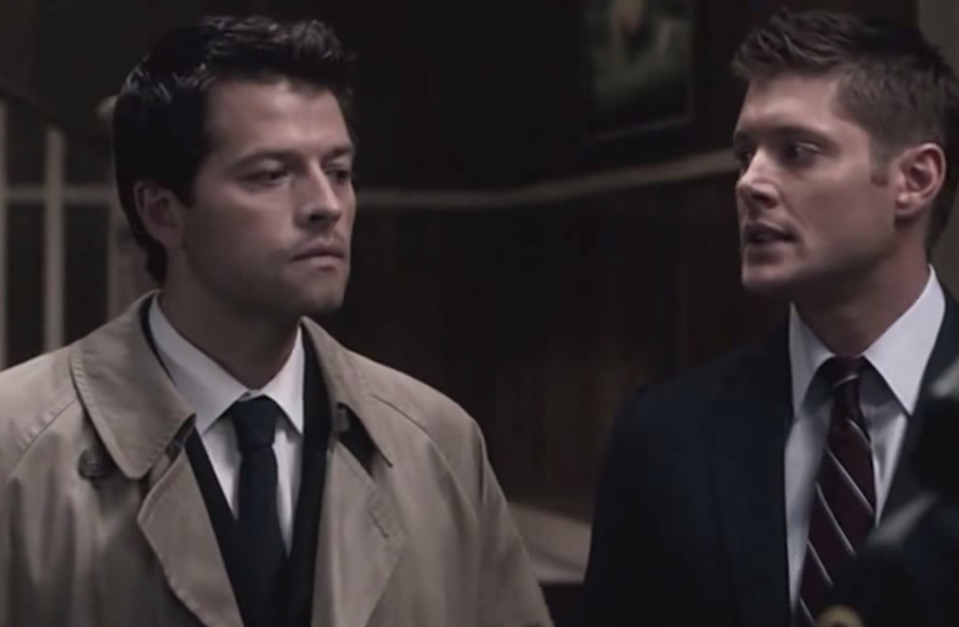 Dean Winchester looksexasperated at Castiel, who stands with a blank look on his face