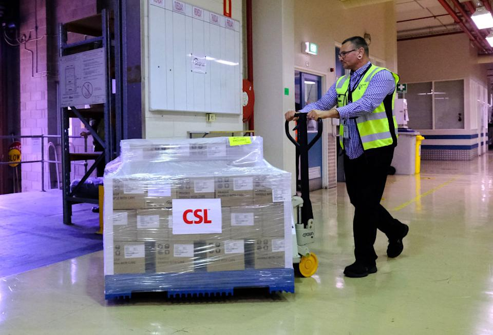 A worker at CSL rolls out the first batch of the AstraZeneca vaccine in Melbourne, Australia, onto a truck.