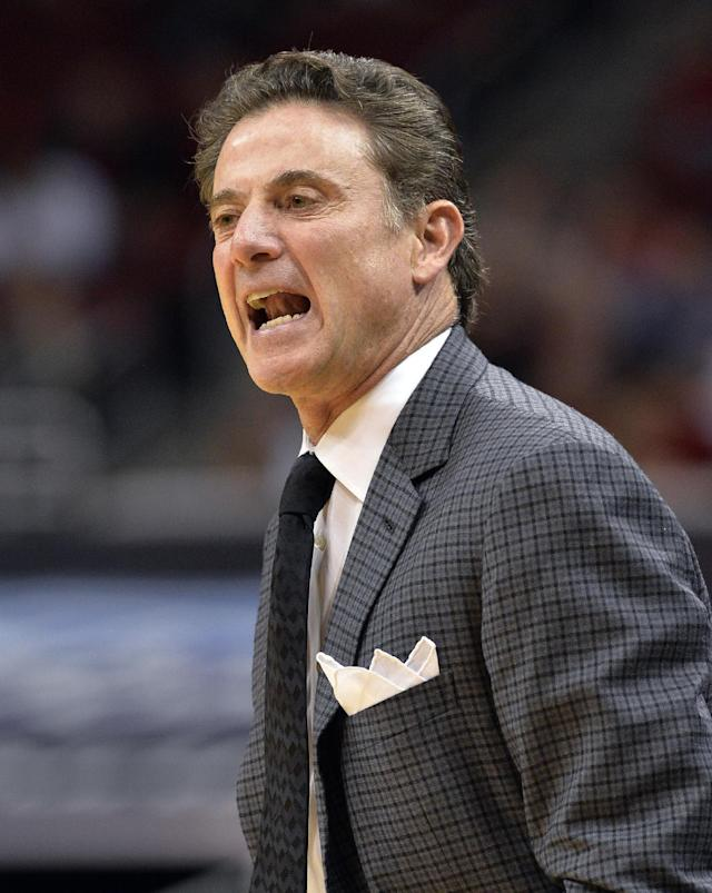 Louisville coach Rick Pitino shouts instructions to his team during the first half of an NCAA college basketball exhibition game against Pikeville on Wednesday, Nov. 6, 2013, in Louisville, Ky. (AP Photo/Timothy D. Easley)