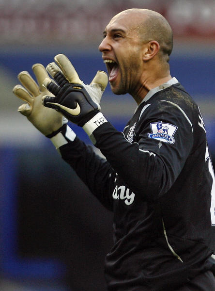 FILE - In this Feb. 15, 2009 file photo, Everton's goalkeeper Tim Howard reacts after their fifth round English FA Cup soccer match against Aston Villa at Goodison Park Stadium, Liverpool, England. United States goalkeeper Tim Howard has extended his contract at Everton Thursday March 8, 2012, tying him to the Premier League club until 2016. If the 33-year-old Howard stays at the northwest club until the end of his new deal, he will have spent 10 years at Goodison Park after having initially signed on loan for Everton from Manchester United in 2006. (AP Photo/Paul Thomas File)