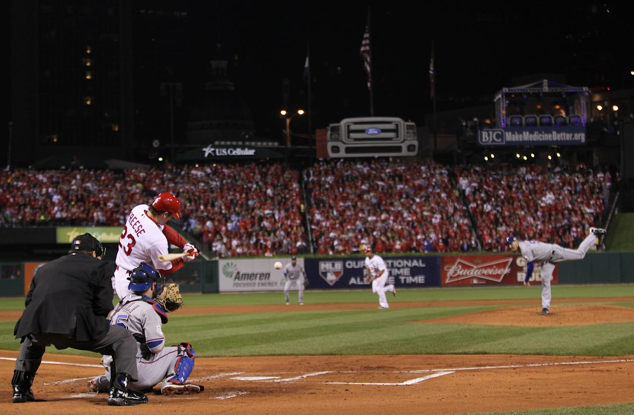 St. Louis Cardinals' David Freese hits a two-run double during the first inning of Game 7 of baseball's World Series against the Texas Rangers Friday, Oct. 28, 2011, in St. Louis. (AP Photo/Ezra Shaw, Pool)