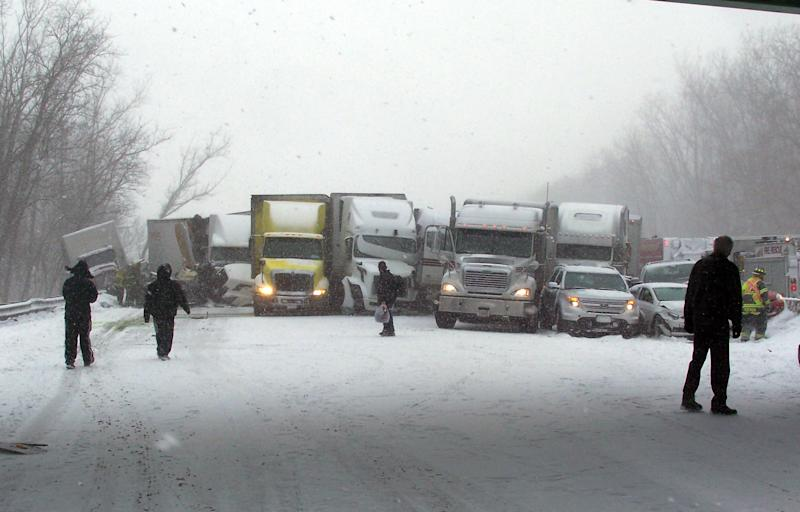 This photo provided by the Indiana State Police onThursday, Jan 23, 2014, shows the scene multi-vehicle crash involving several trucks and cars in Porter, Ind. One person was killed in the accident where several tractor-trailers jackknifed and collided. Several passenger cars also were involved. Interstate 94 is closed at State Highway 49 eastbound. (AP Photo/Indiana State Police)