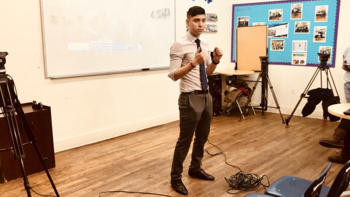 Antonio Alacaron, a DACA recipient and immigration youth organizer, speaks at a State of the Union watch party in Queens. (Photo: Caitlin Dickson/Yahoo News)