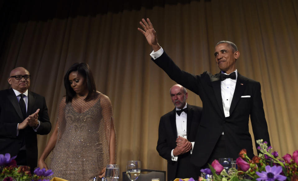 <p>President Obama waves after speaking at the annual White House Correspondents' Dinner, April 30. Joining him are, from left, Larry Wilmore, guest host from Comedy Central; first lady Michelle Obama; and Jerry Seib of the Wall Street Journal. <i>(Photo: Susan Walsh/AP)</i></p>