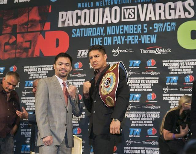 Manny Pacquiao (left) will meet Jessie Vargas on Nov. 5. (AP)