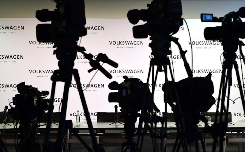 Empty chairs are pictured prior to a press conference at Volkswagen headquarters in Wolfsburg, Germany, on September 25, 2015 (AFP Photo/John MacDougall)