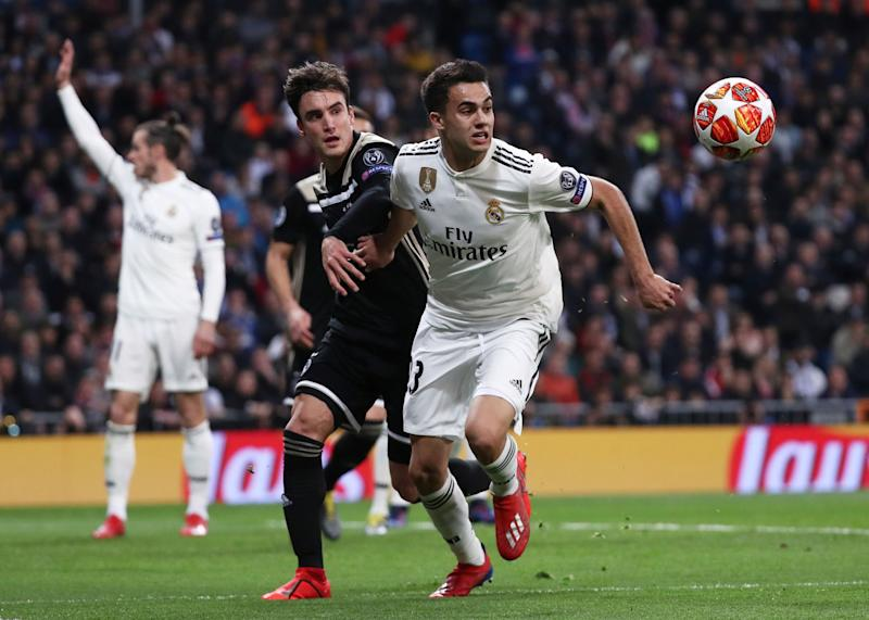 Soccer Football - Champions League - Round of 16 Second Leg - Real Madrid v Ajax Amsterdam - Santiago Bernabeu, Madrid, Spain - March 5, 2019 Real Madrid's Sergio Reguilon in action with Ajax's Nicolas Tagliafico REUTERS/Sergio Perez