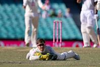 Tim Paine reacts after dropping a catch off India's Hanuma Vihari, one of three the Australia captain put down