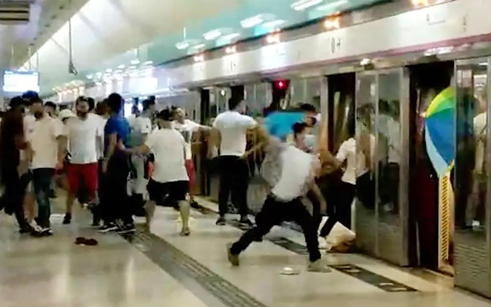 Men dressed in white attack protesters and other commuters at Yuen Long MTR station in 2019. Photo: Handout