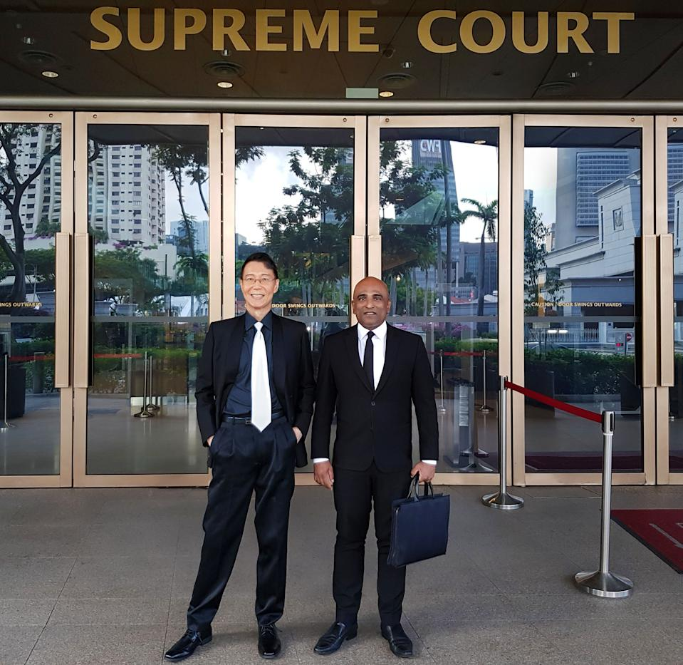 Roy Tan Seng Kee, a retired general practitioner and LGBT activist, with his lawyer.