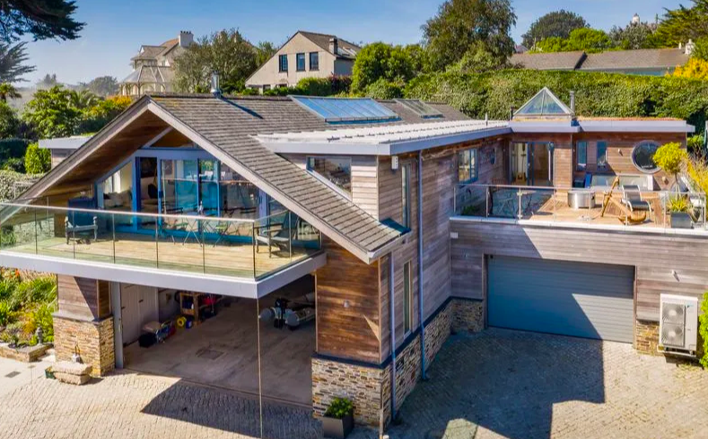 """<p>Like something from Grand Designs, this spectacular award-winning home in Truro, Cornwall, has caught our eye. It might be on the market for £3.2 million, but it has contemporary <a href=""""https://www.housebeautiful.com/uk/decorate/a36379892/interior-tweaks-happy-home/"""" rel=""""nofollow noopener"""" target=""""_blank"""" data-ylk=""""slk:interiors"""" class=""""link rapid-noclick-resp"""">interiors</a>, four bedrooms, a ground floor games room, private sun terrace with a hot tub, plus direct access to the sea. </p><p><a href=""""https://www.zoopla.co.uk/for-sale/details/58152172/"""" rel=""""nofollow noopener"""" target=""""_blank"""" data-ylk=""""slk:This property is currently on the market for £3,250,000 with H Tiddy via Zoopla."""" class=""""link rapid-noclick-resp"""">This property is currently on the market for £3,250,000 with H Tiddy via Zoopla.</a><br></p>"""
