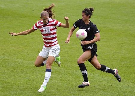 USA's Alex Morgan (L) and New Zealand's Abby Erceg struggle for possession during their women's quarter final soccer match at the London 2012 Olympic Games at St James' Park in Newcastle, northern England August 3, 2012. REUTERS/Nigel Roddis/File Photo