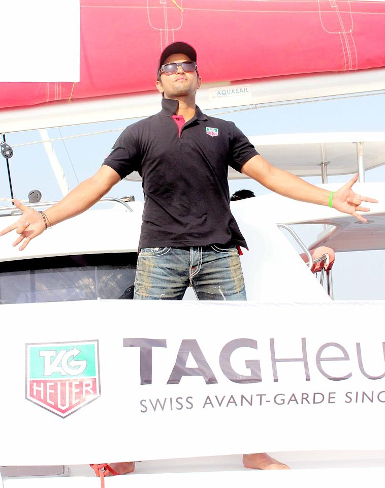 Suresh Raina gets a feel of things during a boating event at the Gateway of India