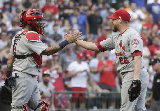 St. Louis Cardinals' Bud Norris congratulates catcher Yadier Molina after a baseball game against the Milwaukee Brewers Saturday, June 23, 2018, in Milwaukee. The Cardinals won 3-2. (AP Photo/Morry Gash)