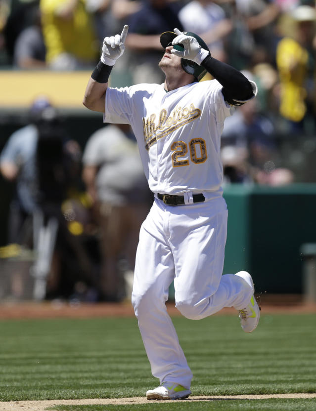 Oakland Athletics' Josh Donaldson celebrates after hitting a home run off Detroit Tigers' Drew Smyly in the third inning of a baseball game Monday, May 26, 2014, in Oakland, Calif. (AP Photo/Ben Margot)