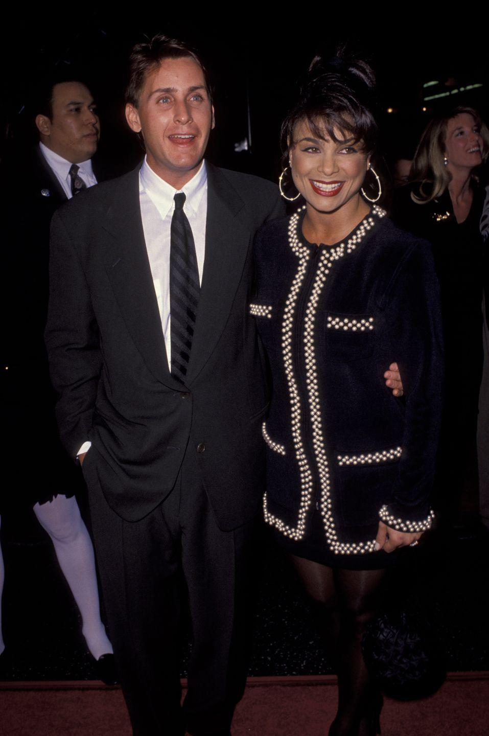 """<p>For those of you who don't know, before Paula Abdul's name was synonymous with <em>American Idol</em>, she was a big pop star in the '80s and '90s and she was married to another '80s star, Brat Pack member Emilio. (Emilio is also Martin Sheen's oldest son and Demi Moore's former fiancé, so there's that.) The couple got married in Santa Monica in 1992 but divorced two years later, reportedly because Paula wanted kids and Emilio (who already had two) didn't. <a href=""""https://ew.com/article/1998/04/24/paula-abdul-and-emilio-estevez-together-forever/"""" rel=""""nofollow noopener"""" target=""""_blank"""" data-ylk=""""slk:Paula told People"""" class=""""link rapid-noclick-resp"""">Paula told<em> People</em></a>, """"It was very hard for him to admit that he couldn't handle having kids again. It was heartbreaking for us both.""""</p>"""