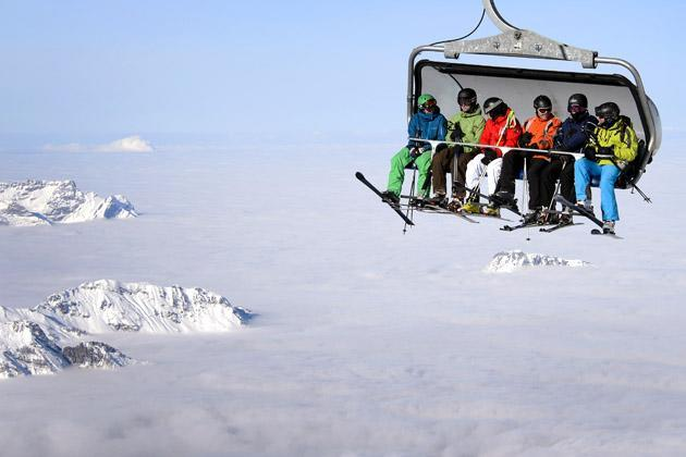 Skiers are seen on a cable car above the fog on December 1, 2012 in the Titlis mountain above Engelberg, Central Switzerland. AFP PHOTO / FABRICE COFFRINI