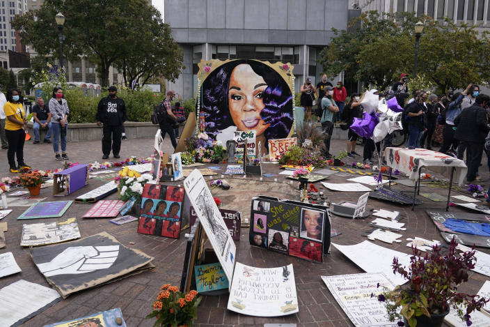 People gather in Jefferson Square awaiting word on charges against police officers, Wednesday, Sept. 23, 2020, in Louisville, Ky. A grand jury has indicted one officer on criminal charges six months after Breonna Taylor was fatally shot by police in Kentucky. The jury presented its decision against fired officer Brett Hankison Wednesday to a judge in Louisville, where the shooting took place. (AP Photo/Darron Cummings)