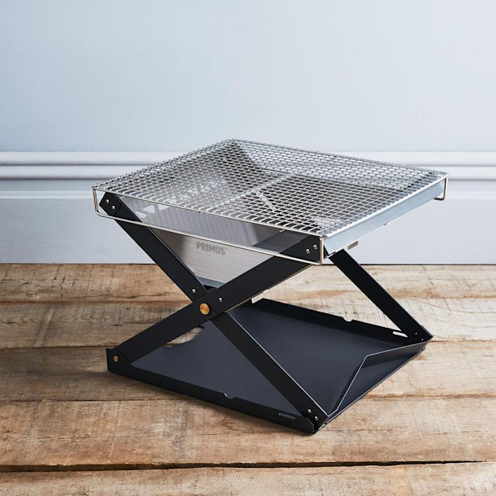 """This steel fire pit folds up flat, making it perfect for campers and travelers. But even if you aren't an avid camper, it's a solid choice for an everyday, backyard fire pit. $150, Food52. <a href=""""https://food52.com/shop/products/4813-kamoto-folding-fire-pit-open-fire-pan"""" rel=""""nofollow noopener"""" target=""""_blank"""" data-ylk=""""slk:Get it now!"""" class=""""link rapid-noclick-resp"""">Get it now!</a>"""