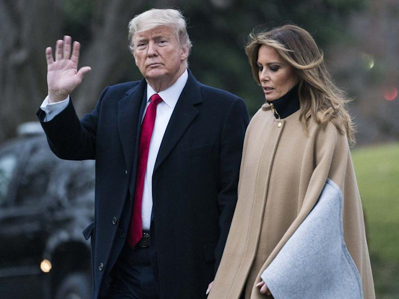 US president Donald Trump and first lady Melania Trump walk along the South Lawn to Marine One as they depart from the White House: Sarah Silbiger/Getty