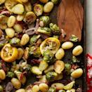 <p>In this quick vegetarian dinner recipe, you can skip boiling the gnocchi--they'll cook through while roasting on the sheet pan with the rest of the ingredients. If you can't find Meyer lemons, use 1 small regular lemon in Step 2 and use 4 teaspoons lemon juice and 2 teaspoons orange juice in Step 4.</p>
