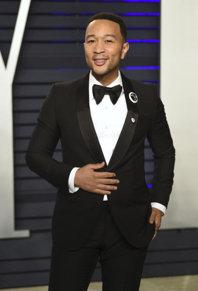 """FILE - This Feb. 24, 2019 file photo shows John Legend at the Vanity Fair Oscar Party in Beverly Hills, Calif. Legend is nominated for a Grammy for best traditional pop vocal album with his holiday album, """"A Legendary Christmas."""" (Photo by Evan Agostini/Invision/AP, File)"""