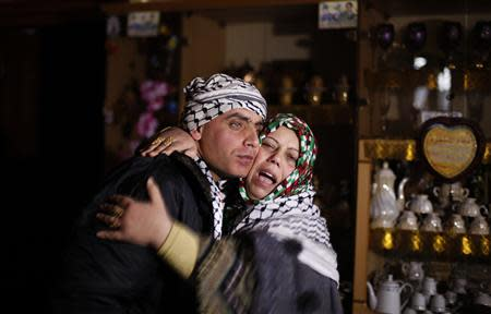 Freed Palestinian prisoner Rami Barbakh, who was held by Israel for 20 years, is hugged by his mother at his house in Khan Younis, in the southern Gaza Strip December 31, 2013. Israel freed 26 Palestinian prisoners on Tuesday, days before U.S. Secretary of State John Kerry was due back in the Middle East to press the two sides to agree a framework peace deal. REUTERS/Ibraheem Abu Mustafa