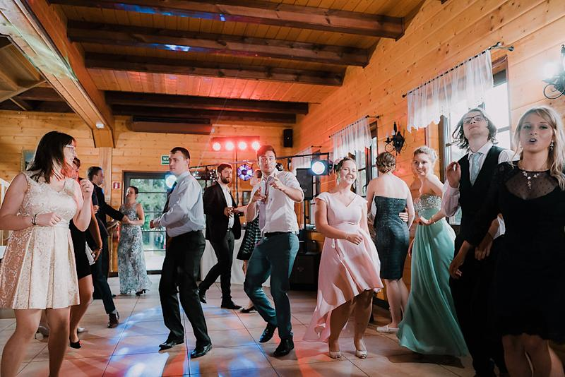 The wedding-goers enjoy themselves on the dance floor. [Photo: Bureniusz]