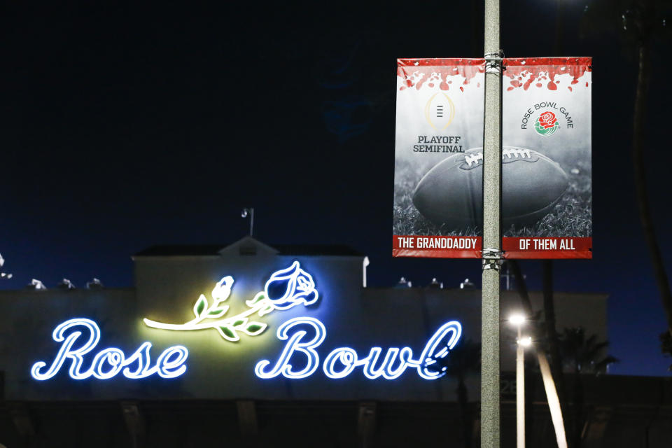A sign promoting the Rose Bowl Game is seen outside the Rose Bowl Stadium Saturday, Dec. 19, 2020, in Pasadena, Calif. No. 13 Southern California became the sixth Pac-12 team to opt out of a bowl game Saturday, Dec. 19, 2020 citing a recommendation from team doctors and discussions with players. (AP Photo/Ringo H.W. Chiu)