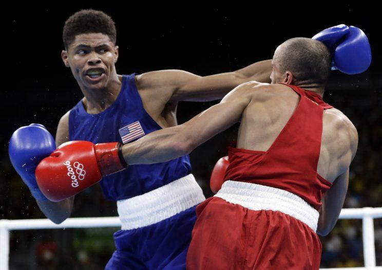 Shakur Stevenson (L) lands a punch during his win on Sunday. (AP)