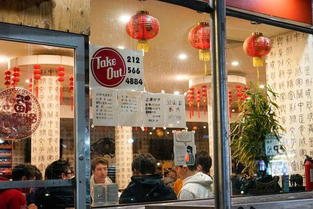 PHOTO: People eat inside the New Shanghai Deluxe restaurant as indoor dining resumes in the Chinatown neighborhood of New York City, Feb. 12, 2021. (Frank Franklin Ii/AP, FILE)