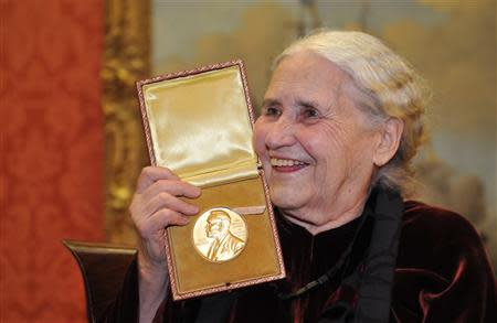 British novelist Doris Lessing is seen smiling as she poses with her Nobel Prize for Literature at the Wallace Collection in London in this January 30, 2008 file photograph. Lessing has died her publisher said on Sunday. REUTERS/Toby Melville/Files