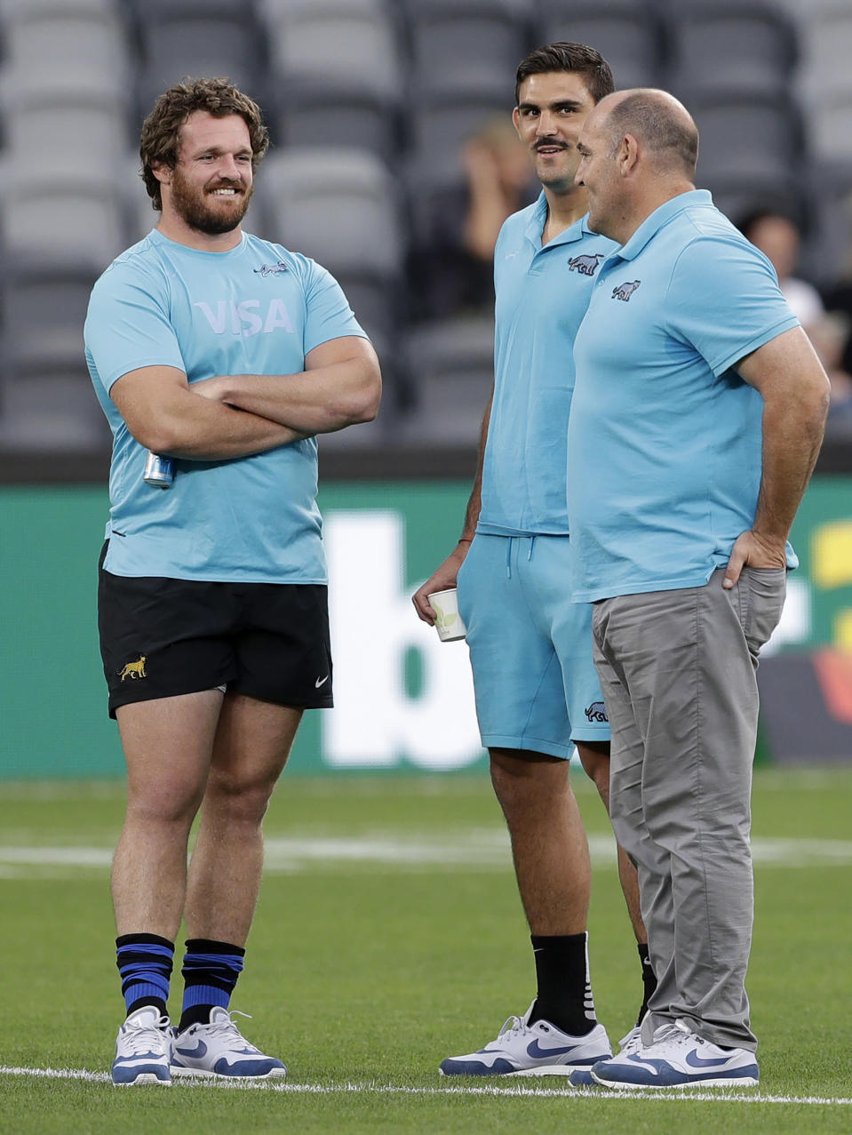 Argentina's Pablo Matera, second right, and Julian Montoya talk with head coach Mario Ledesma on the field prior to their Tri-Nations rugby union match against Australia in Sydney, Australia, Saturday, Dec. 5, 2020. (AP Photo/Rick Rycroft)