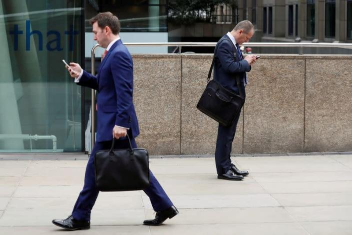 FILE PHOTO: The Wider Image: Phones and the city