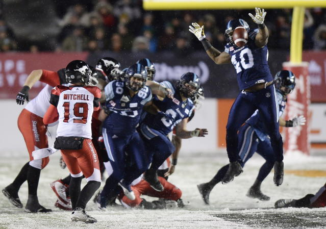 Toronto Argonauts' Shawn Lemon blocks a pass thrown by Calgary Stampeders quarterback Bo Levi Mitchell during the second half of a CFL football game in the Grey Cup in Ottawa on Sunday, Nov. 26, 2017. (Justin Tang/The Canadian Press via AP)