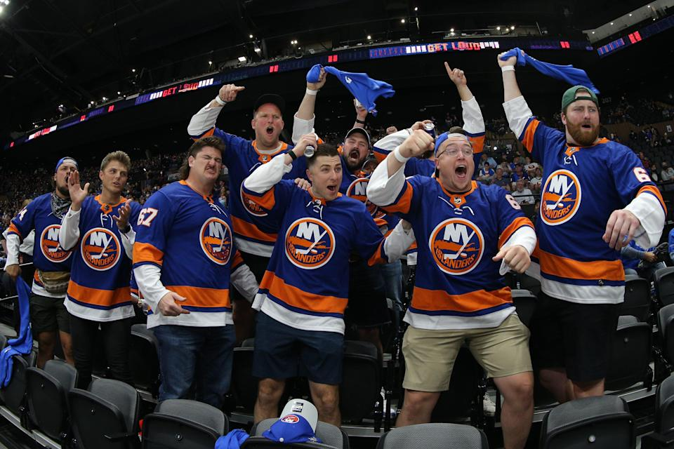 Members of the New York Jets cheer during the first round. They returned for the Bruins series, too.