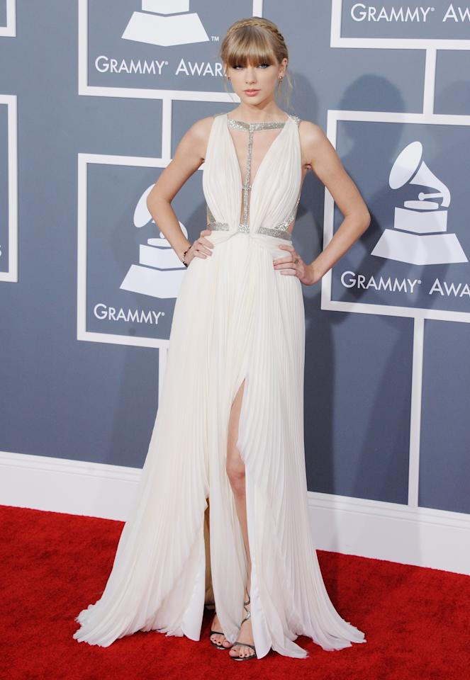 The lovely Taylor Swift went for a J. Mendel plunging neckline gown at the Grammys.