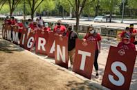 Immigration rights activists demand action on citizenship during a rally across from the White House in Washington, DC