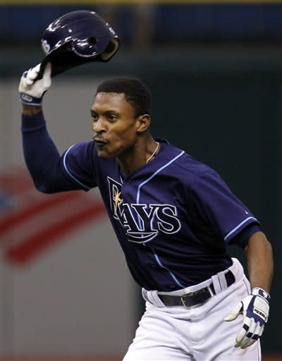 Tampa Bay Rays' B.J. Upton reacts after hitting the game-winning RBi double off Toronto Blue Jays relief pitcher Darren Oliver during the 11th inning of a baseball game Wednesday, May 23, 2012, in St. Petersburg, Fla. The Rays won 5-4. (AP Photo/Chris O'Meara)