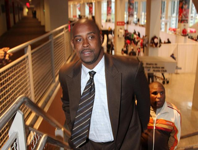 Kenny Anderson attends a Nets game in 2012. (Getty)