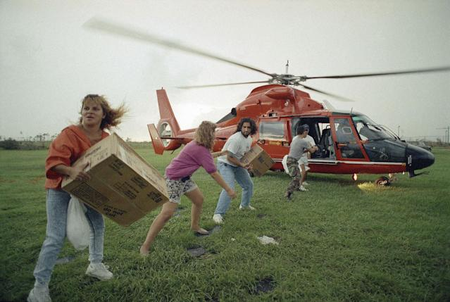 <p>Emergency supplies are taken off a military helicopter at the Campbell Middle School in Homestead, Fla., Aug. 29, 1992, for distribution to victims of Hurricane Andrew, which ripped through the area last Monday. More than 250,000 persons were left homeless in the storm. (AP Photo/David Bergman) </p>