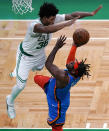 Boston Celtics guard Marcus Smart (36) tries to block a shot by Oklahoma City Thunder forward Luguentz Dort, right, during the second half of an NBA basketball game, Tuesday, April 27, 2021, in Boston. (AP Photo/Charles Krupa)