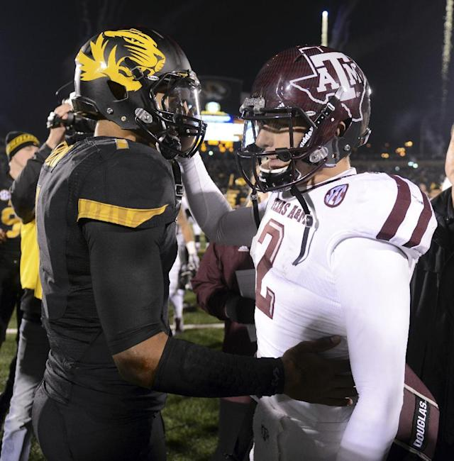 Missouri quarterback James Franklin, left, and Texas A&M quarterback Johnny Manziel greet each other following Missouri's 28-21 victory in an NCAA college football game on Saturday, Nov. 30, 2013, in Columbia, Mo. (AP Photo/L.G. Patterson)