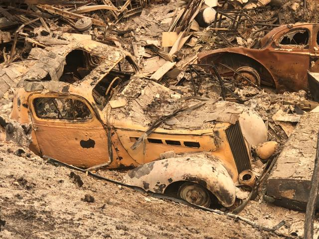 <p>An antique car, part of a collection, lays in rubble in a devastated neighborhood July 29, 2018 near Redding,Calif., where firefighters say only 5 percent of a nearly 90,000 acre fire has been contained. (Photo: Gianrigo Marletta/AFP/Getty Images) </p>