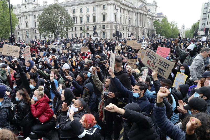Protesters gather in Parliament Square during the Black Lives Matter protest rally in Whitehall, London, in memory of George Floyd who was killed on May 25 while in police custody in the U.S. city of Minneapolis. (Gareth Fuller/PA via AP)