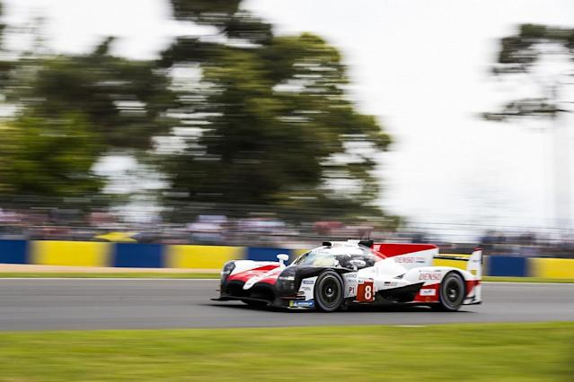 Fernando Alonso regained the lead of the Le Mans 24 Hours in the fifth hour, overtaking Toyota stablemate Jose Maria Lopez shortly after a safety car restart