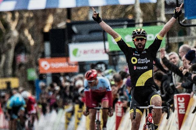 Winning style: Jerome Cousin celebrates winning the fifth stage of the Paris-Nice (AFP Photo/JEFF PACHOUD)