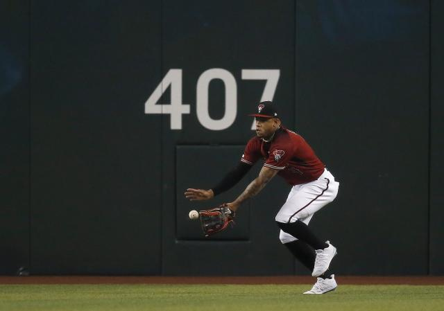 Arizona Diamondbacks center fielder Ketel Marte makes a running catch on a ball hit by Milwaukee Brewers' Lorenzo Cain during the first inning of a baseball game Sunday, July 21, 2019, in Phoenix. (AP Photo/Ross D. Franklin)
